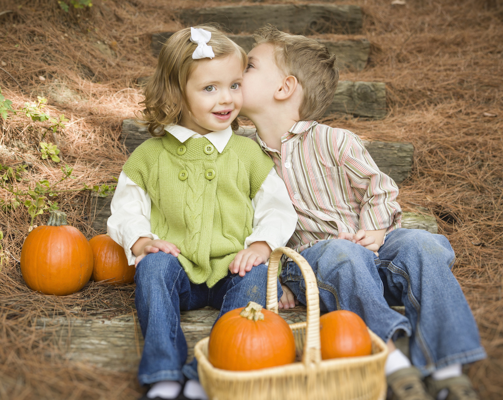 Adorable Brother and Sister Children Sitting on Wood Steps with Pumpkins Whispering Secrets or Kissing Cheek. (Adorable Brother and Sister Children Sitting on Wood Steps with Pumpkins Whispering Secrets or Kissing Cheek., ASCII, 110 components, 110 by